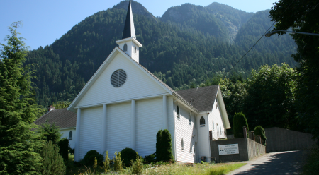 White Colonial Church on a hill dedicated in 1985